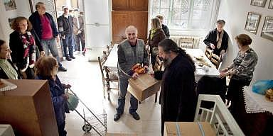 Athens residents patiently wait their turn for dry food parcels