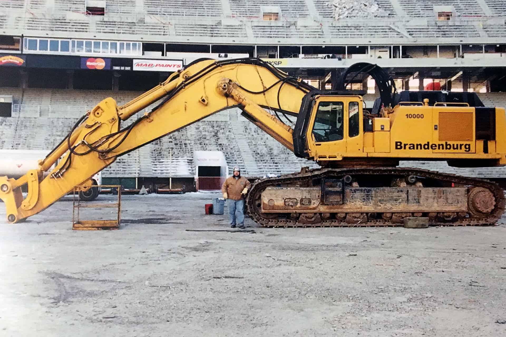 Nick Peetros with a crane during demolition inside the stadium.